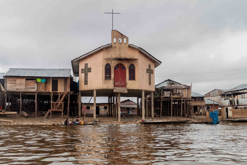 2015: View of a church in partially floating shantytown in Belen neigbohood of Iquitos, Peru. Photo Matyas Rehak / Adobe Stock